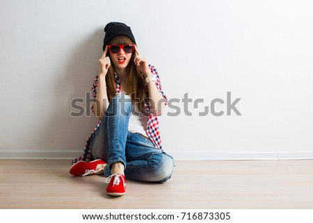 young girlfriend in sunglasses with smartphone in hands make selfie, having fun. Modern Lifestyle