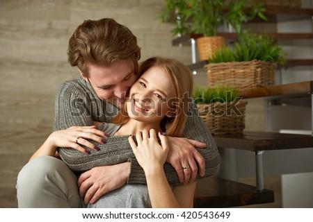Young girlfriend playing ukulele for her boyfriend  - stock photo