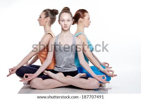 Young girls do yoga - stock photo