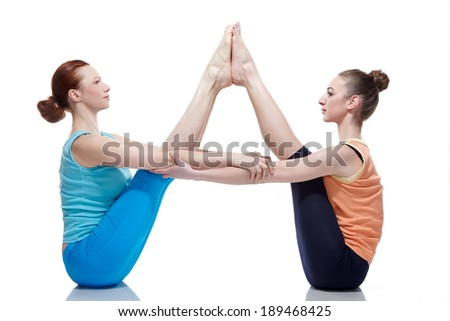 Young girls do yoga - stock photo