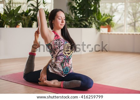 young girls doing yoga on pink mat indoors. - stock photo