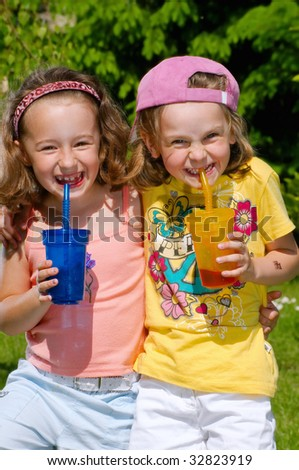 Young girls drink lemonade - stock photo