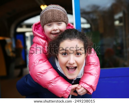 Young girls having fun in the city - stock photo