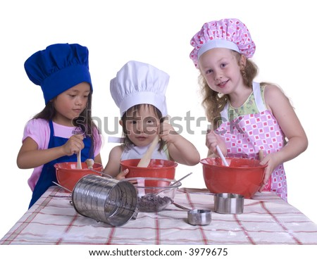 young girls having fun in the kitchen making a mess....I mean making something special..... Education, learning, cooking, childhood - stock photo