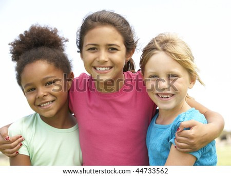 Young Girls In Playing In Park - stock photo