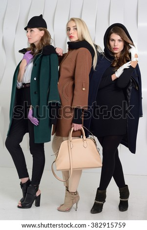 Young Girls Studio Posing Coats Stock Photo 379250455 - Shutterstock