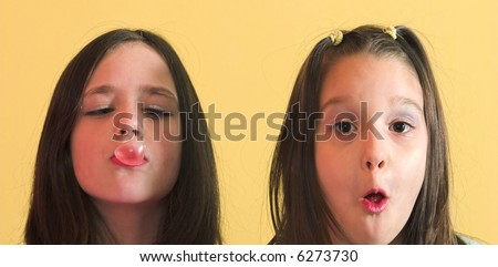 Young girls making a bubble from chewing gum - stock photo
