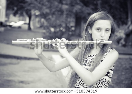 young girls playing the flute - stock photo