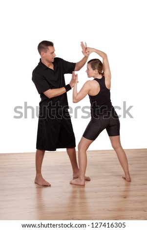 Young girls practicing with a male fitness professional trainer