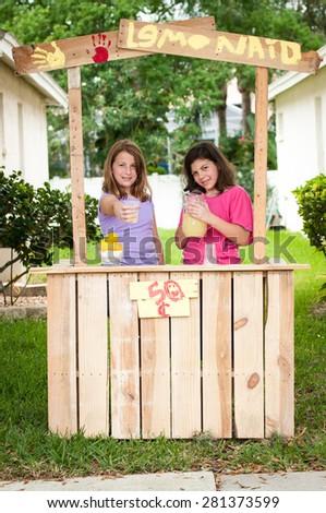 Young girls selling lemonade - stock photo