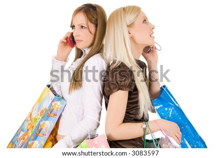 Young girls shopping and talking on the phone isolated on white background