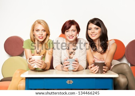 young girls sitting on a sofa smiling