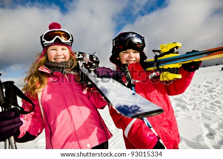 Young girls skiing in the Alps, an outdoor shoot.