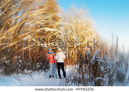 Young girls skiing in winter forest - stock photo