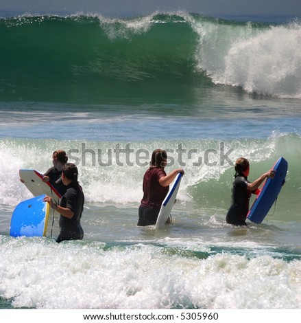 Young girls surfing in California - stock photo