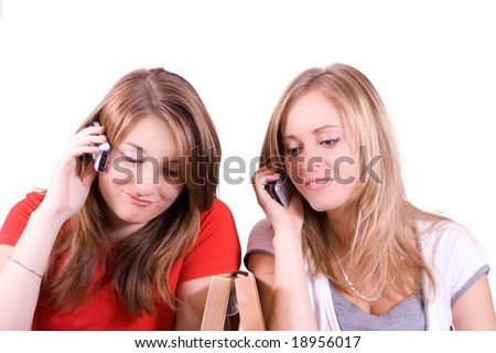 young girls talking on the cell phone isolated on white - stock photo