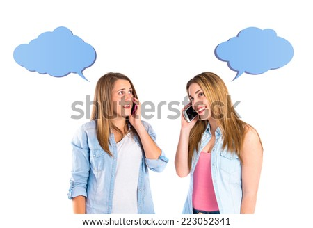 Young girls talking to mobile over white background  - stock photo