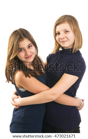 Young girls teenagers embracing and having fun. Teenagers friendship
