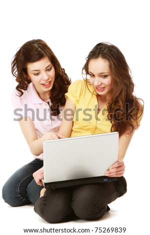 Young girls with a laptop - stock photo