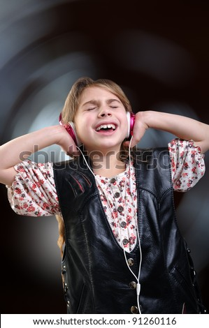 young girls with headphones against bright background