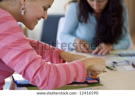 Young girls working on their Scrap books