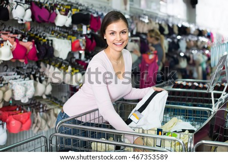 Young glad woman shopping comfortable panties in lingerie department