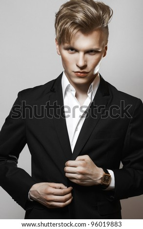 Young glamour handsome man in suit - stock photo