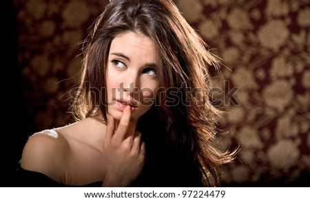 Young glamour woman portrait. Studio shot - stock photo