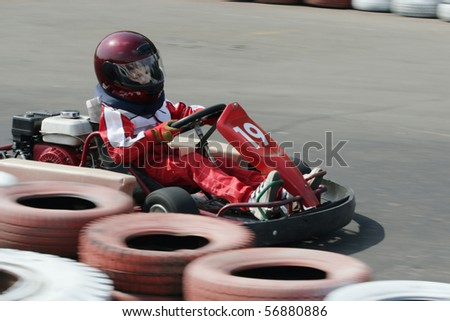 Young go cart race on circuit