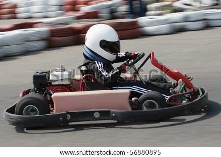 Young go cart race on circuit - stock photo