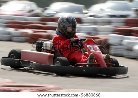 Young go cart racer on circuit - stock photo