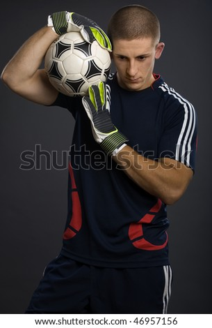 Young goal keeper in soccer game - stock photo