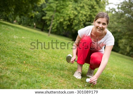 young golfer placing a golf ball on the tee - stock photo