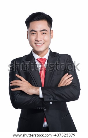 Young good looking asian business man on a white background isolated.  - stock photo
