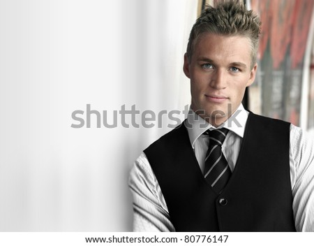 Young good looking businessman with copy space - stock photo