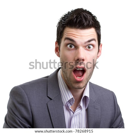 Young good looking suited man smiling for a close-up - stock photo