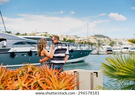 Young, good pair of walking in the port of San Remo - stock photo