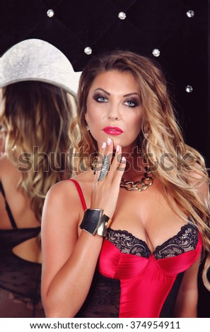 Young gorgeous blond woman in sexy lingerie in boudoir - stock photo