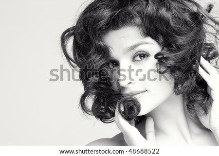 young gorgeous brunette model posing, space for copy - stock photo