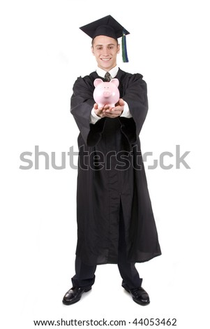Young graduate in cap and gown holding a piggy bank.