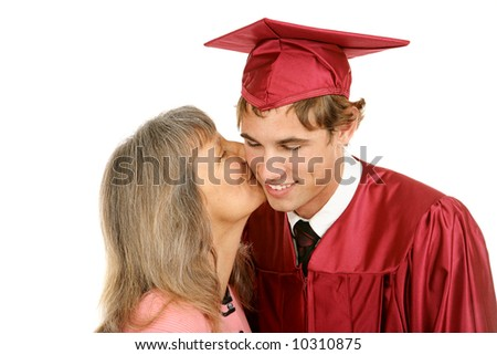 Young graduate receiving a kiss from his mother.  Isolated on white. - stock photo