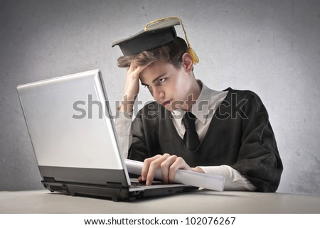 Young graduate student using a laptop