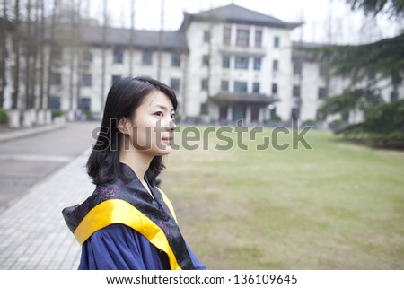 young graduate walking in campus with happy - stock photo