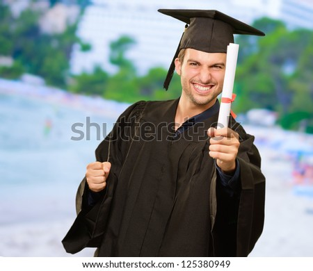 Young Graduation Man Holding Certificate, Outdoor