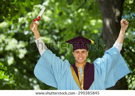 Young Graduation Man Holding Certificate, Outdoor - stock photo
