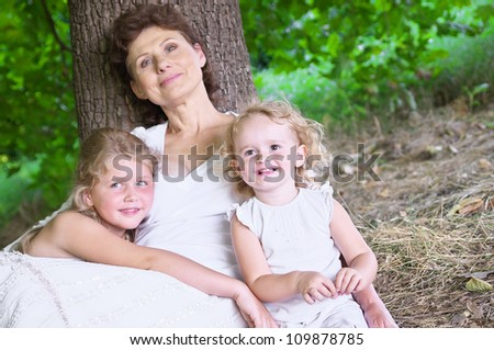 Young grandmother with grandchildren in the park