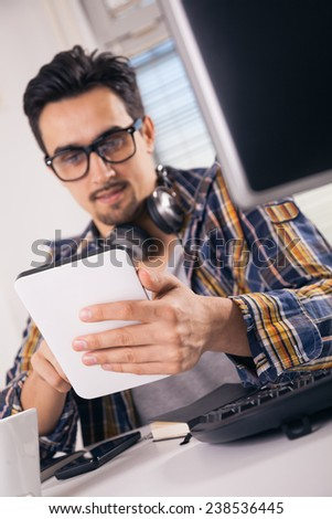 Young graphic designer using digital tablet - stock photo