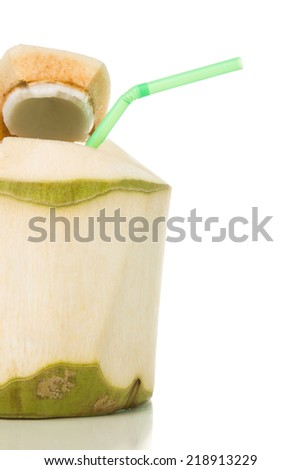 Young green coconut with drinking straw isolated on white background. - stock photo