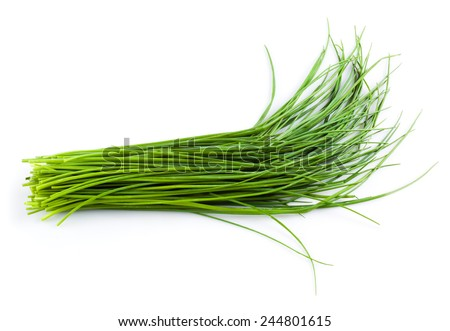 Young green onion leaves isolated on white. - stock photo