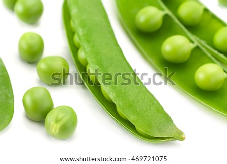 Young green peas closeup isolated on white background